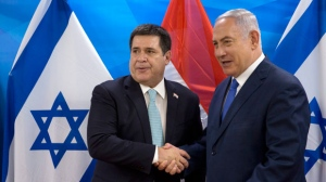 Israeli Prime Minister Benjamin Netanyahu, right, shakes hands with Paraguay's President Horacio Cartes during their meeting at the Prime Minister's office in Jerusalem, Monday, May 21, 2018. Paraguay opened its new embassy in Jerusalem on Monday, following in the footsteps of the United States and Guatemala. (AP Photo/Sebastian Scheiner, Pool)