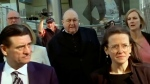 In this image made from video, Archbishop Philip Wilson, center, heads to Newcastle Local Court, north of Sydney, Australia Tuesday, May 22, 2018. The Australian archbishop who was the most senior Roman Catholic cleric in the world charged with covering up child sex abuse was convicted Tuesday. (Australian Broadcasting Corporation via AP)