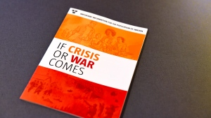 "Sweden's Civil Contingencies Agency presents the advice booklet ""If Crisis or War Comes"" during a press conference in Stockholm, Monday May 21, 2018. Sweden is distributing an updated version of a Cold War-era civil emergency advice booklet to some 4.8 million households about what to do in the event of a crisis, including war. (Pontus Lundahl/TT via AP)"