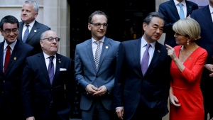 Argentina's Foreign Secretary Jorge Faurie, second from left, Germany's Foreign Minister Heiko Maas, third from left, China's Foreign Minister Wang Yi, second from right, and Australia's Foreign Affairs Minister Julie Bishop talk before the group picture during the G20 foreign ministers meeting at San Martin Palace in Buenos Aires, Argentina, Monday, May 21, 2018. (AP Photo/Natacha Pisarenko)