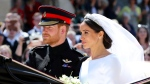 Britain's Prince Harry and his wife Meghan Markle leave after their wedding ceremony, at St. George's Chapel in Windsor Castle in Windsor, near London, England, Saturday, May 19, 2018. (Gareth Fuller/pool photo via AP)