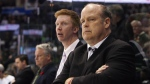 Mark Hunter, right, and Jeff Paul, looks on during a break in second period action against the Edmonton Oil Kings at the Memorial Cup CHL hockey tournament in London, Ont., Sunday, May 18, 2014. The Toronto Maple Leafs have lost another executive. The Leafs announced Tuesday that the club and assistant general manager Mark Hunter have mutually agreed to part ways. THE CANADIAN PRESS/Dave Chidley