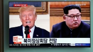 In this May 11, 2018, file photo, people watch a TV screen showing file footage of U.S. President Donald Trump, left, and North Korean leader Kim Jong Un, right, during a news program at the Seoul Railway Station in Seoul, South Korea. (AP Photo/Lee Jin-man, File)