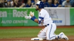 Toronto Blue Jays' Devon Travis reacts after hitting a triple during seventh inning AL baseball action against the Boston Red Sox in Toronto on Thursday, April 26, 2018. THE CANADIAN PRESS/Nathan Denette