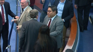 Newly appointed Ward 33 Coun. Jonathan Tsao shakes hands with Mayor John Tory at city hall on Tuesday afternoon.