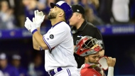 Toronto Blue Jays designated hitter Kendrys Morales (8) celebrates after hitting a two-run home run against Los Angeles Angels starting pitcher Garrett Richards scoring Jays Russell Martin in first inning American League baseball action in Toronto on Tuesday, May 22, 2018. THE CANADIAN PRESS/Frank Gunn