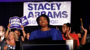 Georgia Democratic gubernatorial candidate Stacey Abrams smiles before speaking to supporters during an election-night watch party, Tuesday, May 22, 2018, in Atlanta. (AP Photo/John Bazemore)