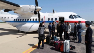South Korean journalists arrive at the Kalma Airport in Wonsan, North Korea, Wednesday, May 23, 2018. Eight journalists from South Korea departed for rival North Korea on Wednesday after the North allowed them to join the small group of foreign media in the country to witness the dismantling of its nuclear test site this week, Seoul officials said. (Yonhap via AP)