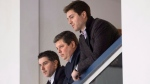 Dave Nonis, centre, senior vice-president and GM of the Toronto Maple Leafs, watches the team practice with Brandon Pridham, left, assistant to the GM, and Kyle Dubas, assistant GM, following the firing of head coach Randy Carlyle in Toronto on Tuesday, January 6, 2015. THE CANADIAN PRESS/Darren Calabrese