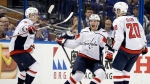Washington Capitals left wing Andre Burakovsky, center, celebrates his goal against the Tampa Bay Lightning with teammates Dmitry Orlov, left, and Lars Eller (20) during the second period of Game 7 of the NHL hockey playoffs Eastern Conference finals Wednesday, May 23, 2018, in Tampa, Fla. (AP Photo/Chris O'Meara)