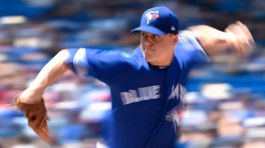 Toronto Blue Jays relief pitcher Aaron Loup (62) pitches to the Los Angeles Angels during sixth inning American League baseball action in Toronto on Wednesday, May 24, 2018. THE CANADIAN PRESS/Nathan Denette