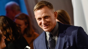 In this Monday, April 9, 2018, file photo, actor Daniel Craig attends The Opportunity Network's 11th Annual Night of Opportunity Gala at Cipriani Wall Street in New York. After more than a decade at Sony Pictures, James Bond has a few new homes. In a joint announcement with their new partners Thursday, May 24, 2018, Michael G. Wilson and Barbara Broccoli said Universal Pictures will release the 25th installment of the superspy franchise internationally while MGM will release the film in the U.S. Craig will be reprising his role as 007 in the film and Oscar-winner Danny Boyle will direct. (Photo by Evan Agostini/Invision/AP, File)