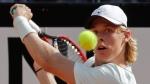 Canada's Denis Shapovalov returns the ball to Spain's Rafael Nadal, at the Italian Open tennis tournament in Rome, Thursday, May 17, 2018 (AP Photo/Alessandra Tarantino)