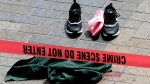 Clothing is strewn on the sidewalk at a scene where pedestrians were hit by a motorist in Portland, Ore., Friday, May 25, 2018. Police say three women have been injured in a hit-and-run crash near Portland State University. (AP Photo/Don Ryan)