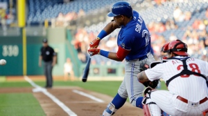 Toronto Blue Jays' Yangervis Solarte, front left, hits a run-scoring double off Philadelphia Phillies starting pitcher Zach Eflin during the first inning of a baseball game, Friday, May 25, 2018, in Philadelphia. Phillies catcher Jorge Alfaro, right, looks on. (AP Photo/Matt Slocum)