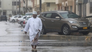 "An Oman man walks down the street under the rain in Salalah, Oman, Friday, May 25, 2018. The Indian Meteorological Department, which tracks a cyclone heading toward the coast of Oman, says that country's city of Salalah is ""expected to experience maximum wind and maximum rainfall and also the maximum storm surge.""(AP Photo/Kamran Jebreili)"