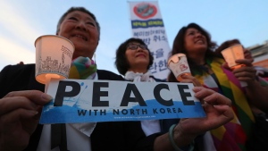"Protesters hold candle lights during a rally to denounce the United States' policies against North Korea near the U.S. embassy in Seoul, South Korea, Friday, May 25, 2018. North Korea said Friday that it's still willing to sit down for talks with the United States ""at any time, at any format"" just hours after President Donald Trump abruptly canceled his planned summit with the North's leader Kim Jong Un. (AP Photo/Ahn Young-joon)"