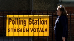 A woman leaves a polling station after casting her vote in the referendum on the 8th Amendment of the Irish Constitution, in Dublin, Ireland, Friday May 25, 2018. The referendum on whether to repeal the country's strict anti-abortion law is being seen by anti-abortion activists as a last-ditch stand against what they view as a European norm of abortion-on-demand, while for pro-abortion rights advocates, it is a fundamental moment for declaring an Irish woman's right to choose. (AP Photo/Peter Morrison)