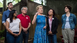 Ontario Liberal Leader Kathleen Wynne speaks to media alongside candidates, left to right, Sumi Shan, David Morris, David Zimmer, Li Koo, Jo-Ann Davis in the backyard of Marie-Andree Maurice in Toronto on Saturday, May 26, 2018. THE CANADIAN PRESS/Aaron Vincent Elkaim