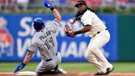 Philadelphia Phillies' Maikel Franco, right, throws to first base for a double play as Toronto Blue Jays' Kevin Pillar slides during the eighth inning of a baseball game, Saturday, May 26, 2018, in Philadelphia. Curtis Granderson was out at first. (AP Photo/Derik Hamilton)