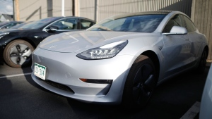 In this Sunday, May 27, 2018, photo a pair of 2018 Model 3's sit at a Tesla dealership in Littleton, Colo. (AP Photo/David Zalubowski)