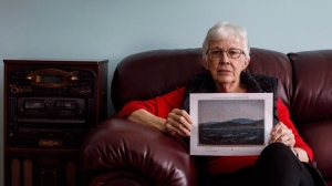 Glenna Gardiner holds a picture of her painting in Edmonton Alta, on Wednesday March 28, 2018. The Edmonton grandmother recently learned that a family heirloom that had been sitting in her basement was a painting by the Group of Seven's Tom Thomson, which has been priced at up to $175,000 by Heffel Fine Art Auction House.THE CANADIAN PRESS/Jason Franson