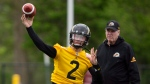 "The newest addition to the CFL Hamilton Tiger Cats roster, quarterback Johnny Manziel (2) is seen with teammates on the field at McMaster University during Tiger Cats training camp in Hamilton, Ont., on Sunday, May 20, 2018. The former NFLer and Heisman Trophy winner signed a two-year deal with the Hamilton Tiger Cats to further his career after a long break calling the deal his ""best opportunity for me moving forward."" THE CANADIAN PRESS/Peter Power"
