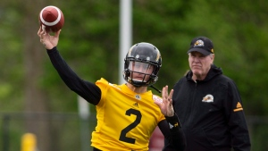 """The newest addition to the CFL Hamilton Tiger Cats roster, quarterback Johnny Manziel (2) is seen with teammates on the field at McMaster University during Tiger Cats training camp in Hamilton, Ont., on Sunday, May 20, 2018. The former NFLer and Heisman Trophy winner signed a two-year deal with the Hamilton Tiger Cats to further his career after a long break calling the deal his """"best opportunity for me moving forward."""" THE CANADIAN PRESS/Peter Power"""