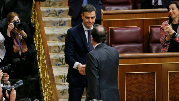 Spain's new leader takes aim at corruption, austerity