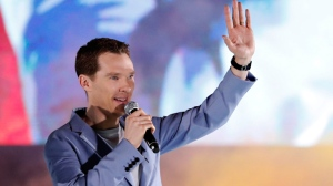 "In this Monday, April 16, 2018 file photo, Benedict Cumberbatch waves to fans during Marvel's Avengers: Infinity War red carpet fan event in Singapore. Food-delivery firm Deliveroo has thanked Benedict Cumberbatch after the ""Sherlock"" star reportedly fought off muggers who were attacking a cyclist working for the company. Uber driver Manuel Dias told the Sun newspaper that he was driving Cumberbatch and his wife Sophie Hunter along London's Marylebone High Street when they saw a cyclist being hit with a bottle. (AP Photo/Yong Teck Lim, File)"