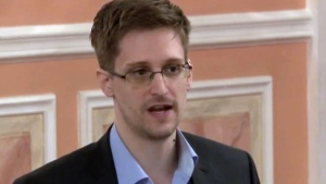 In this file image made from video released by WikiLeaks on Oct. 11, 2013, former National Security Agency systems analyst Edward Snowden speaks in Moscow.  (AP Photo, File)