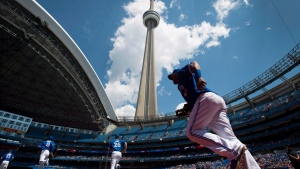 Members of the Toronto Blue Jays take to the field prior to MLB baseball action against the Oakland Athletics in Toronto on Saturday, May 24, 2014. (THE CANADIAN PRESS/Darren Calabrese)