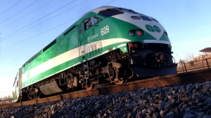 A GO Train passes along a stretch of tracks alongside the Don Valley Parkway in Toronto on Friday, April 5, 2013. (CTV Toronto / Maurice Cacho)