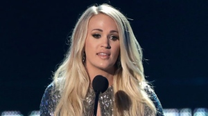 """Carrie Underwood accepts the female video of the year for """"The Champion"""" at the CMT Music Awards at the Bridgestone Arena on Wednesday, June 6, 2018, in Nashville, Tenn. (AP Photo/Mark Humphrey)"""