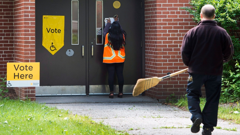 Workers prepare for voters to cast their vote for the Ontario election in Toronto, on Thursday, June 7, 2018. THE CANADIAN PRESS/Nathan Denette