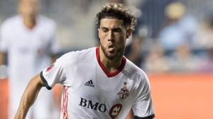 Toronto FC's Jonathan Osorio brings the ball up the field during the second half of the team's MLS soccer match against the Philadelphia Union, Friday, June 8, 2018, in Chester, Pa. Toronto FC won 2-0. (AP Photo/Chris Szagola)