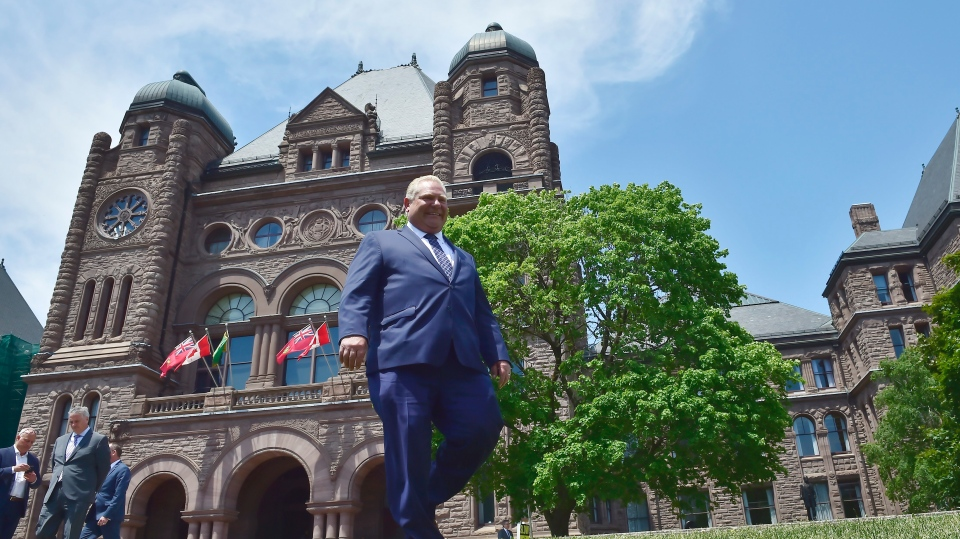 Ontario premier-elect Doug Ford walks out onto the front lawn of the Ontario Legislature at Queen's Park in Toronto on Friday, June 8, 2018. THE CANADIAN PRESS/Frank Gunn