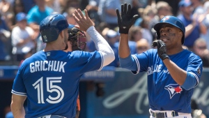 Toronto Blue Jays' Curtis Granderson, right, celebrates with teammate Randal Grichuk after hitting a three run home run against the Baltimore Orioles in the fourth inning of their American League MLB baseball game in Toronto on Sunday June 10, 2018. THE CANADIAN PRESS/Fred Thornhill