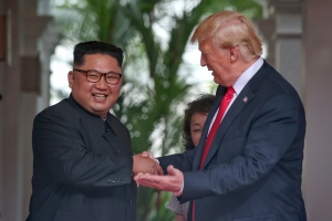 U. S. President Donald Trump shakes hands with North Korea leader Kim Jong Un at the Capella resort on Sentosa Island Tuesday, June 12, 2018 in Singapore. (Kevin Lim/The Straits Times via AP)