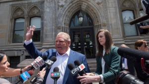 Ontario Premier-designate Doug Ford speaks to reporters before heading into Whitney Block for a meeting with his transition team in Toronto, Sunday, June 10, 2018. THE CANADIAN PRESS/Marta Iwanek