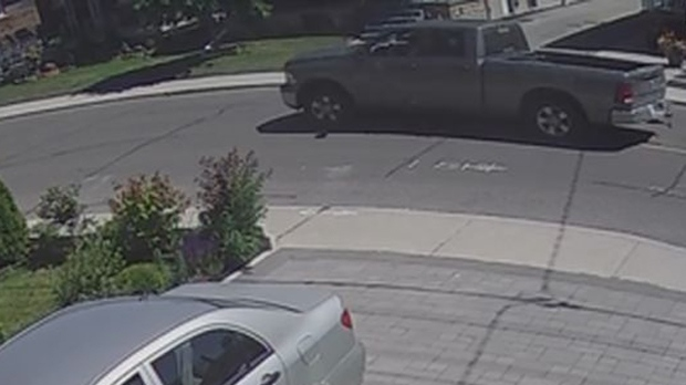 A Dodge Ram pickup believed to be involved in a fatal hit-and-run on June 11 is shown in a surveillance camera image. (TPS)