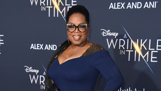 "FILE - In this Feb. 26, 2018 file photo, Oprah Winfrey arrives at the world premiere of ""A Wrinkle in Time"" in Los Angeles. Winfrey will serve as godmother of a new Holland America ship called the Nieuw Statendam.  (Photo by Jordan Strauss/Invision/AP, File)"