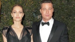 In this Nov. 16, 2013 file photo, Maddox Jolie-Pitt, from left, Angelina Jolie and Brad Pitt attend the 2013 Governors Awards in Los Angeles. The FBI says it will not file charges against Brad Pitt stemming from an alleged dispute with his family aboard a private flight. The FBI released a statement Tuesday, Nov. 22, 2016, saying it has reviewed the circumstances of the alleged incident and will not pursue further investigation. (Photo by John Shearer/Invision/AP, File)
