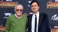 """In this April 23, 2018 file photo, Stan Lee, left, and Keya Morgan arrive at the world premiere of """"Avengers: Infinity War"""" in Los Angeles. Lee has taken out a restraining order against Morgan who had been acting as his business manager and close adviser. Lee took out the order Wednesday, two days after Morgan was arrested on suspicion of filing a false police report. (Photo by Jordan Strauss/Invision/AP, File)"""