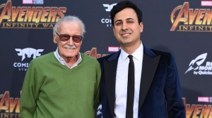"In this April 23, 2018 file photo, Stan Lee, left, and Keya Morgan arrive at the world premiere of ""Avengers: Infinity War"" in Los Angeles. Lee has taken out a restraining order against Morgan who had been acting as his business manager and close adviser. Lee took out the order Wednesday, two days after Morgan was arrested on suspicion of filing a false police report. (Photo by Jordan Strauss/Invision/AP, File)"