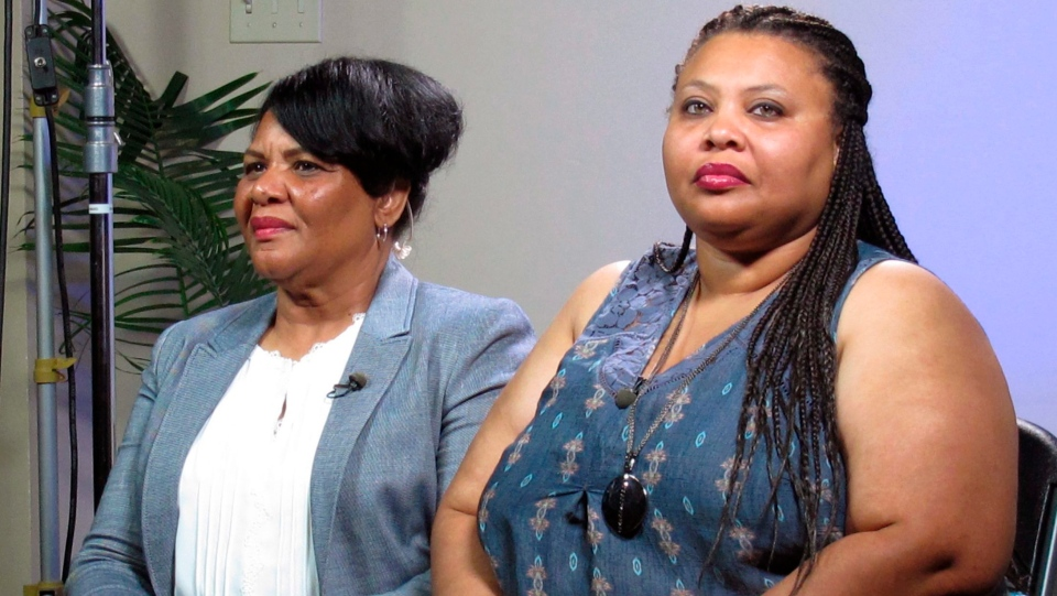 Alice Marie Johnson, left, and her daughter Katina Marie Scales wait to start a TV interview on Thursday, June 7, 2018 in Memphis, Tenn. (AP Photo/Adrian Sainz).