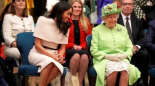 The Queen and Meghan, Duchess of Sussex visit the Storyhouse Chester, in Chester, England, on Thursday, June 14, 2018. (Phil Noble/Pool Photo via AP)
