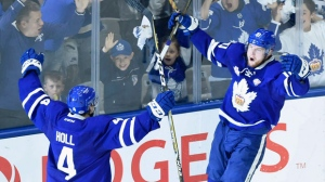 Toronto Marlies' Carl Grundstrom celebrates his goal with teammate Justin Holl (4) during third period AHL Calder Cup playoff action against the Texas Stars in Toronto on Thursday June 14, 2018. THE CANADIAN PRESS/ Nathan Denette