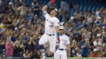 Toronto Blue Jays' Yangervis Solarte leaps in the air rounding third base for the second time on the night hitting a two run home run against the Washington Nationals in the seventh inning of their Interleague MLB baseball game in Toronto on Friday June 15, 2018. THE CANADIAN PRESS/Fred Thornhill