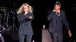 In this Nov. 4, 2016 file photo, Beyonce, center, and Jay-Z perform in Cleveland. ( AP Photo/Matt Rourke, File)